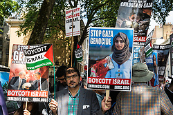 London, UK. 10th June, 2018. Hundreds of people wait outside the Saudi embassy to take part in the pro-Palestinian Al Quds Day march through central London organised by the Islamic Human Rights Commission. An international event, it began in Iran in 1979. Quds is the Arabic name for Jerusalem.