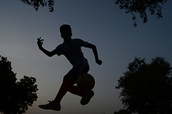 June 14, 2018 - Allahabad, India - An indian youth footballer controls football during a game , ahead of Fifa World Cup 2018 , in Allahabad on June 14 , 2018 . Russia is hosting 2018 world cup football , starts from June 14 ,2018  (Credit Image: © Ritesh Shukla/NurPhoto via ZUMA Press)