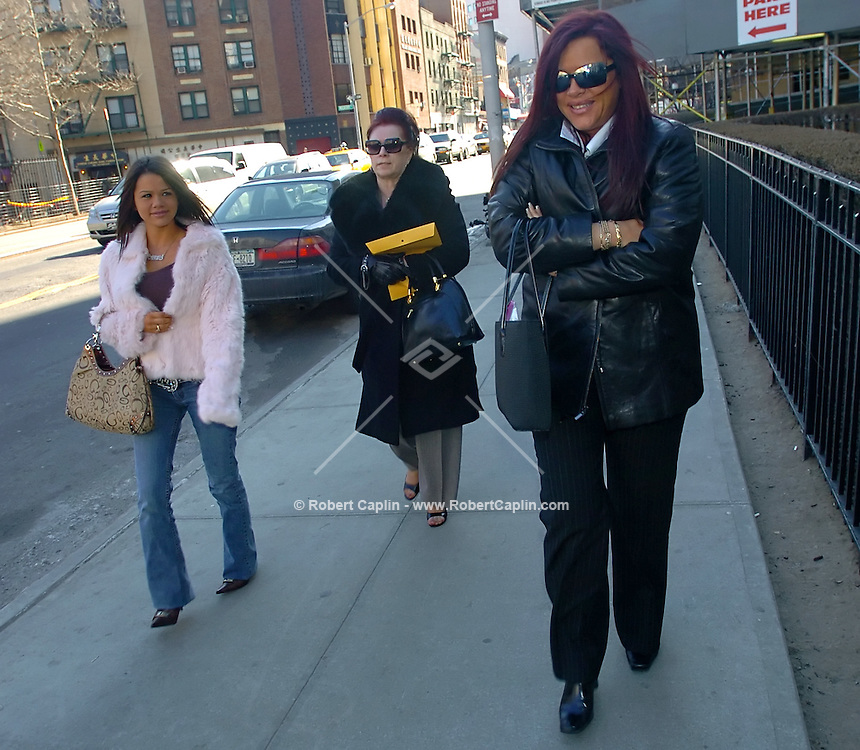 Victoria Gotti, center, mother of John Gotti Jr., Angel Gotti, right, sister, and unconfirmed/unidentified family member, left, walk into court for the trial of John Gotti Jr at 500 Pearl Street in Manhattan Wed. March 1, 2006.