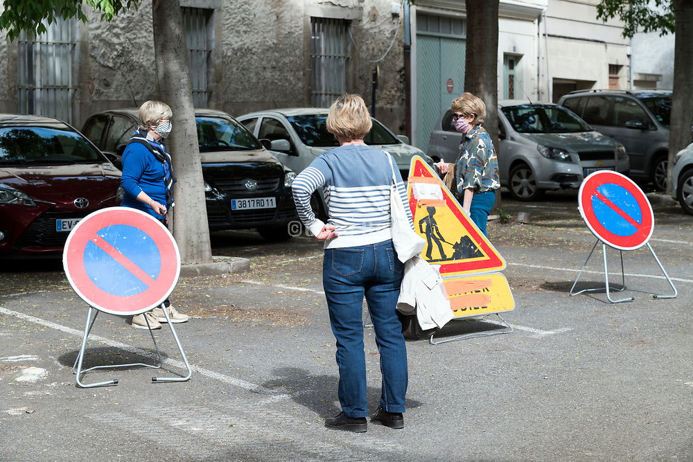 safe social distance meeting in the street during the Covid 19 crisis and lockdown France Limoux April 2020