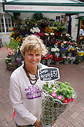 Joannah Shaw is owner of Pinkpansy, a traditional flower shop kiosk selling British Flowers, and also international flowers outside Embankment Underground Station, Central London<br /><br />British local flowers, grown nearby, count for around 10% of the UK market, traveling less than a tenth of their foreign counterparts which are often flown in from abroad. Nearly 90% of the flowers sold in the UK are actually imported, and many travel over 3000 miles. Local flower farms help biodiversity, providing food and habitat to a huge variety of wildlife, insects including butterflies, bugs, and bees. Often local flower farmers prefer to grow organic rather than using pesticides. British flowers bloom all the year around, even in the depths of winter, and there are local flower farms throughout the country.<br /><br />Many people like the idea of the just picked from the garden look, and come to flower farms throughout Britain to pick their own for weddings, parties and garden fetes. Others come for the joy of a day out in the countryside with their family. Often a bride and her family will come to pick the flowers for her own wedding, some even plant the seeds earlier in the year.