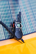 Portable solar panel charging a radio in the backcountry, Sequoia National Park, California