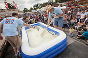 Workers prepare a pool of instant grits at the World Grits Festival April 14, 2012 in St. George, SC. The festival celebrates the southern love for the sticky corn porridge