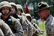 Recruits get an ear full from their drill instructor as he prepares them to march.  Marine Corps Recruit Depot at Parris Island in South Carolina is where all male recruits living east of the Mississippi River and all female recruits from all over the US receive their arduous twelve week training in their quest to become marines. Even though there are two current active wars and a weak economy, recruitment has not been effected.  Actually, recruiting numbers have increased, with more young men and women looking toward the military for answers.