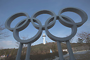The Olympics Rings with Alpensia Ski Jumping Centre in the distance. Alpensia Village on the 9th February 2018 in Pyeongchang-gun, South Korea