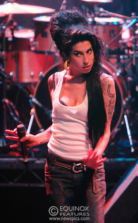 Singer Amy Winehouse, DOB=14/09/1983, performing for her gay fans at the G-A-Y Club. G-A-Y is London's biggest gay club and is held at the London Astoria nightclub, Soho, London, UK. Amy spent much of the show rubbing her itchy nose. She also seemed to have signs of old scars all down one arm...Picture Data:.Photographer: Edward Hirst.Copyright: ©2007 Licensed to Equinox News Pictures +448700 780000.Contact: Equinox Features.Date Taken: 20070415.Time Taken: 015425+0000.www.newspics.com