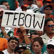 A fan holds up a Tim Tebow sign during an NFL football game between the New York Jets and the Miami Dolphins on Sunday, September 23, 2012 at SunLife Stadium in Miami, Florida. (AP Photo/Alex Menendez)