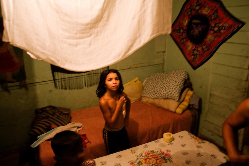 A girl in her family home, Nova Gazela camp.