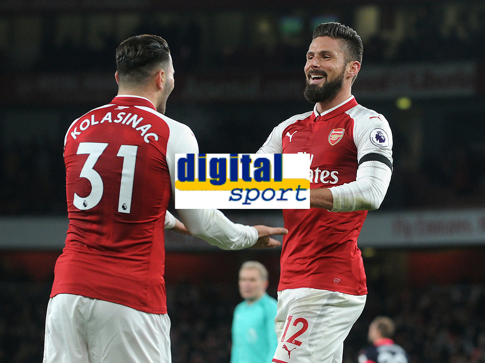 Football - 2017 / 2018 Premier League - Arsenal vs. Huddersfield Town<br /> <br /> Olivier Giroud of Arsenal scores goal no 5 after stealing the ball off Sead Kolasinac (left) at The Emirates.<br /> <br /> COLORSPORT/ANDREW COWIE