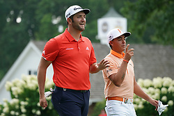 August 12, 2018 - St. Louis, Missouri, United States - Jon Rahm (L) and Rickie Fowler share a laugh during the final round of the 100th PGA Championship at Bellerive Country Club. (Credit Image: © Debby Wong via ZUMA Wire)