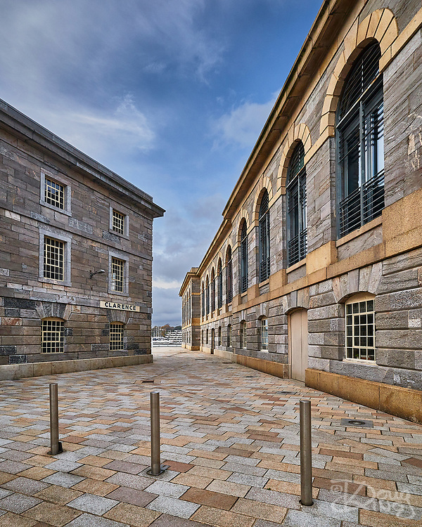 Three posts in the square at the Royal William Yard.<br /> Plymouth, Devon, UK