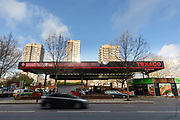 A car travels along the road in front of the Texaco Petrol station on The Highway in east London, England on December 20, 2018.