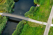 Nederland, Flevoland, Gemeente Almere, 27-08-2013; nieuwbouwwijk Noorderplassen. Jogger in de vroege ochtend.<br /> Rural park in new residential district in Almere. Early runner.<br /> luchtfoto (toeslag op standaard tarieven);<br /> aerial photo (additional fee required);<br /> copyright foto/photo Siebe Swart.