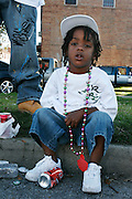 February 28th 2006. .New Orleans, Louisiana. United States..A boy after the Zulu Mardi Gras Walking Parade on Orleans Avenue.