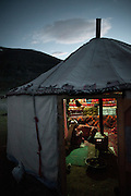 Abdul Walli's yurt as night sets in - Made of interlaced sticks covered with felt, these portable homes are packed up and reassembled twice a year. Wooden doors are imported to the treeless plateau from lower altitudes...Daily life at the Khan (chief) summer camp of Kara Jylga...Trekking through the high altitude plateau of the Little Pamir mountains (average 4200 meters) , where the Afghan Kyrgyz community live all year, on the borders of China, Tajikistan and Pakistan.