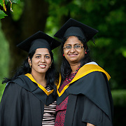 """25.08.2016          <br />  Faculty of Business, Kemmy Business School graduations at the University of Limerick today. <br /> <br /> Attending the conferring were Master of Science in Nursing (Rehabilitation of the Older Person) graduates, Subha Balasubramanian and Nivya P Baby. Picture: Alan Place.<br /> <br /> <br /> As the University of Limerick commences four days of conferring ceremonies which will see 2568 students graduate, including 50 PhD graduates, UL President, Professor Don Barry highlighted the continued demand for UL graduates by employers; """"Traditionally UL's Graduate Employment figures trend well above the national average. Despite the challenging environment, UL's graduate employment rate for 2015 primary degree-holders is now 14% higher than the HEA's most recently-available national average figure which is 58% for 2014"""". The survey of UL's 2015 graduates showed that 92% are either employed or pursuing further study."""" Picture: Alan Place"""