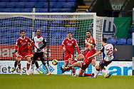 Bolton Wanderers George Thomason(25) shoots during the EFL Sky Bet League 2 match between Bolton Wanderers and Crawley Town at the University of  Bolton Stadium, Bolton, England on 2 January 2021.