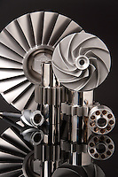 Gears, fans and bearing for the engine on a commercial jet airliner. Shot on reflective plexiglass