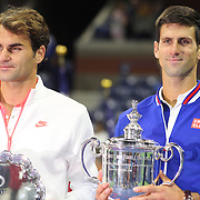Novak Djokovic, (right), Serbia and Roger Federer, Switzerland, at the trophy presnenation after Novak Djokovic, Serbia won the Men's Singles Final against Roger Federer, Switzerland, during the US Open Tennis Tournament, Flushing, New York, USA. 13th September 2015. Photo Tim Clayton