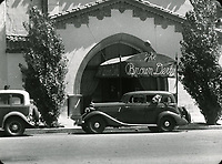 1936 A lion in a car waits to enter The Brown Derby to celebrates his 3rd birthday