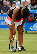 Tara Moore (GBR) holds her leg as she has an injury during her match against Johanna Konta (GBR). The Aegon Open Nottingham 2017, international tennis tournament at the Nottingham tennis centre in Nottingham, Notts , day 2 on Tuesday 13th June 2017.<br /> pic by Bradley Collyer, Andrew Orchard sports photography.