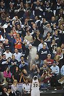 LeBron James goes through a pre game ritual by throwing talcum powder in the air.