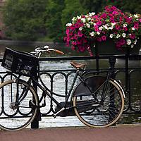 Europe, Netherlands, Amsterdam. Bicycle on canal bridge.