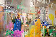 Kylie Brown, 8, of Bentonville, uses a squeegee in the Art Studio at the Scott Family Amazeum on Friday, February 19, 2016, in Bentonville, Arkansas. The studio is a glass wall where children can paint and then use a squeegee to wipe away their work. Beth Hall for the New York Times