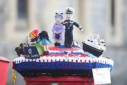 A knitted tapestry created by the Ickenham Postbox Toppers, in honour of the Duke of Edinburgh award, atop a post box in Windsor, Berkshire, following the death of the Duke of Edinburgh at the age of 99 on April 9. Picture date: Friday April 16, 2021.