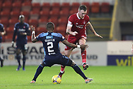 Aberdeen forward Ryan Edmondson (32) is tackled by Hamilton Academicals Hakeem Odoffin (2) during the Scottish Premiership match between Aberdeen and Hamilton Academical FC at Pittodrie Stadium, Aberdeen, Scotland on 20 October 2020.