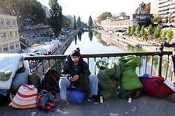 "Migrants stand at the Canal Saint-Martin, near the Jaures and Stalingrad metro stations, in northern Paris, France, on October 31, 2016, during a police operation aiming at a future evacuation of a migrant camp. An operation of ""administrative control"" was underway on early October 31 in the Jaures/Stalingrad quarter before a future evacuation, whose date has not yet been set, according to a police source. The makeshift camp on the outskirts of the 10th and 19th arrondissements in the north of the capital numbers today 2,500 people, according to the City of Paris. Photo by Alain Apaydin/ABACAPRESS.COM"