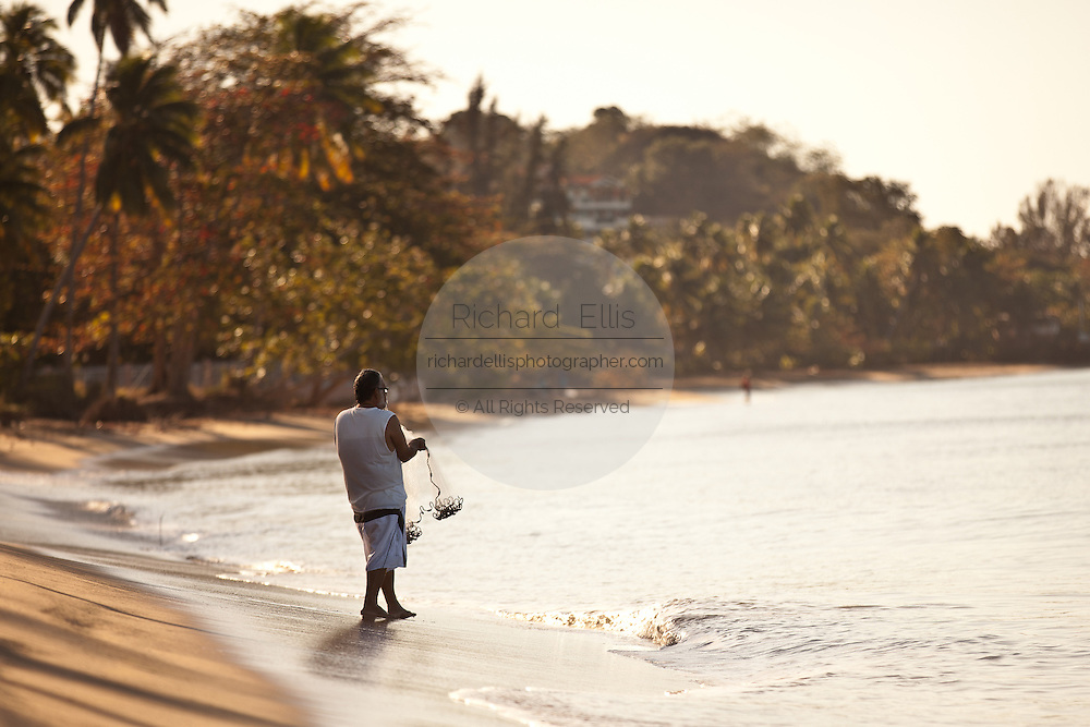 A fisherman prepares his cast net on Corcega Beach in Rincon, Puerto Rico. Rincon is one of the surf capitals of the world.