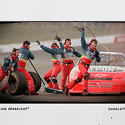 Jeff Gordon's Rainbow Warriors race to finish a pit stop on the No. 24 car during qualifying for The Coca-Cola 600 in 1997. ©Travis Bell Photography