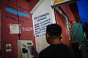 A migrant calls his family in a shelter and asks for money to continue his journey to the United States in Coatzacoalcos, Mexico, on October 5, 2008.