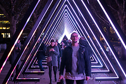 © Licensed to London News Pictures. 17/01/2018. London, UK. People walk thorough an installation entitled 'OSC-L by Ulf Langheinrich' at the Lumiere London festival. Running from 18th-21st January 2018 more than 50 artworks are transforming the capital's streets, buildings and public spaces into an immersive nocturnal art exhibition of light and sound. Locations include King's Cross, Fitzrovia, Mayfair, West End, Trafalgar Square, Westminster, Victoria, South Bank and Waterloo. Photo credit: Peter Macdiarmid/LNP