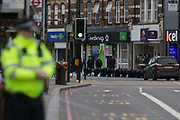 The Streatham High Road remains closed as police officers perform a fingertip search on the crime scene, 24hrs after the terrorist attack in south London, in which Sudesh Amman, 20, was shot dead by police after stabbing people, on 3rd February 2020, in London, England. Amman had been released from prison a week ago after serving half of a sentence for terror offences, and was under police surveillance. Three people were injured but none is in a life-threatening condition.