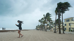 A girl walks along the beach with heavy winds and threatening skies in anticipation for Hurricane Irma Saturday, September 9, 2017 in Hollywood, FL, USA. Photo by Paul Chiasson/CP/ABACAPRESS.COM