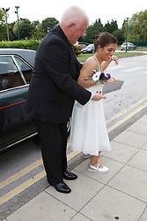 Bride who has cerebral palsy, arriving at wedding ceremony.