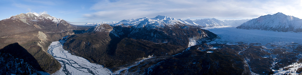 USA, Alaksa,  View from summit of Lion's Head peak of morning sun rising over Matanuska Glacier and Chugach Range mountain peaks at dawn