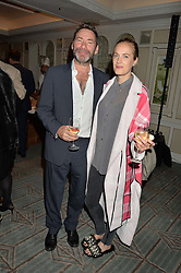 MAT COLLISHAW and POLLY MORGAN at a party hosted by Ewan Venters CEO of Fortnum & Mason to celebrate the launch of The Cook Book by Tom Parker Bowles held at Fortnum & Mason, 181 Piccadilly, London on 18th October 2016.