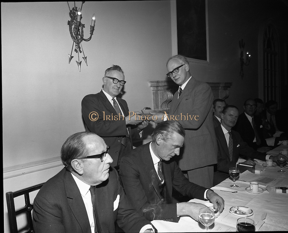 Hovis Family Bakery Competition..1971..23.02.1971..02.23.1971..23rd February 1971..At the Hibernian Hotel, Dublin, Ranks Ireland Ltd.,held the prize giving and celebration lunch for The Hovis Family Bakery Competition winners..Pictured presenting an award to Mr Dan Nelligan, Nelligans Bakery, Castleisland, Kerry is Mr P L Greenwood, Deputy Chairman,Ranks Ireland Ltd.