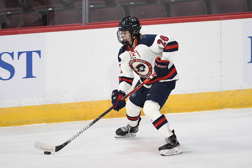 ERIE, PA - MARCH 06: Anna Fairman #26 of the Robert Morris Colonials skates with the puck in the first period during the CHA Tournament Championship game against the Syracuse Orange at the Erie Insurance Arena on March 6, 2021 in Erie, Pennsylvania. (Photo by Justin Berl/Robert Morris Athletics)
