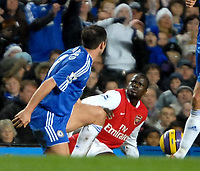 Photo: Ed Godden.<br /> Chelsea v Arsenal. The Barclays Premiership. 10/12/2006. Chelsea's Frank Lampard (L), tussles with Arsenal's Emmanuel Eboue.