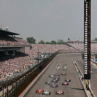 28 May, 2006, Indianapolis Motor Speedway, USA.<br /> Sam Hornish, Jr., Helio Castroneves and Dan Wheldon race for the lead at the start.<br /> © 2006 Phillip Abbott/USA<br /> LAT Photographic
