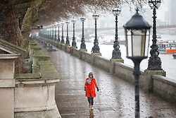 © Licensed to London News Pictures. 13/01/2017. London, UK. People walk along the Thames Embankment near Westminster Bridge whilst snowing in London on Friday, 13 January 2017. Photo credit: Tolga Akmen/LNP