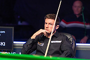 Jack Lisowski sits and watches as Mark Selby is allowed back to the table at the World Snooker 19.com Scottish Open Final Mark Selby vs Jack Lisowski at the Emirates Arena, Glasgow, Scotland on 15 December 2019.