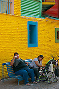 La Boca, Buenos Aires, Argentina. Large tourists on a bench.