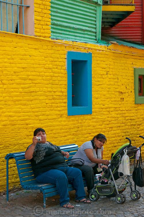 La Boca, Buenos Aires, Argentina. Large tourists on a bench.
