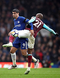Chelsea's Alvaro Morata (left) and West Ham United's Angelo Ogbonna battle for the ball during the Premier League match at Stamford Bridge, London.