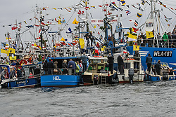June 24, 2017 - Puck, Poland - Fishing boats are seen during the annual Kashubian fishermen sea pilgrimage. Every year fishermen from Kashubia region pay honour to died at the Baltic sea colleagues and pray for  the prosperity of fishing. (Credit Image: © Michal Fludra/NurPhoto via ZUMA Press)